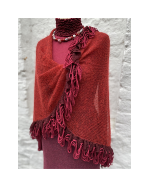 red knitted and twisted wrap with hand appllied trim