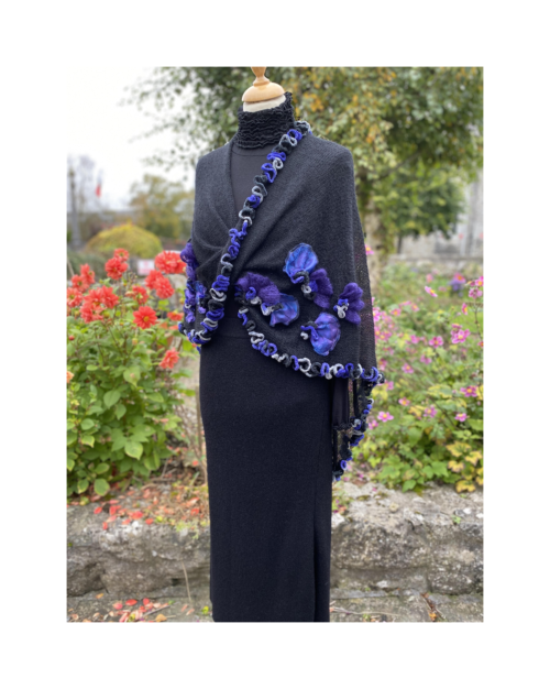 Black knitted twisted wrap stole with hand made decoration by Lucy Erridge