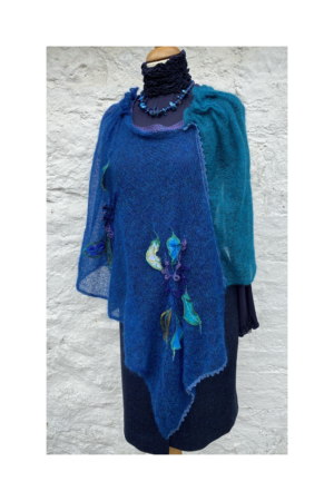 blue knitted hand decorated poncho by designer Lucy Erridg